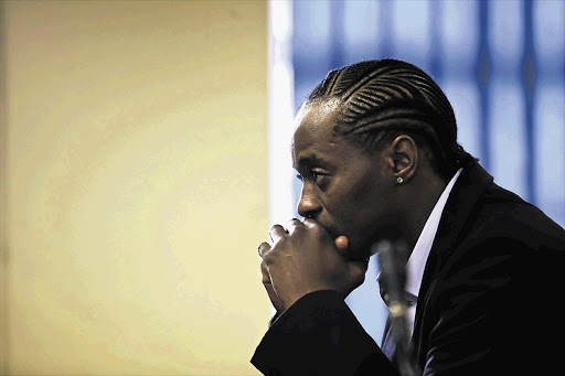 Molemo 'Jub Jub' Maarohanye listens as magistrate Brian Nemavhidi reads out his judgment in the Protea Magistrate's Court, Soweto. The hip-hop artist was found guilty and sentenced to 24 years in prision for killing four children during a drag race.