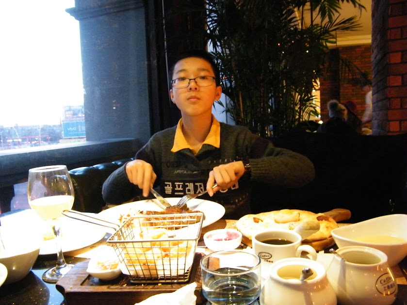 dinning out with dearest son, woz, in 1st dusk lunar 2018 in downtown Qiqihar.