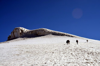 Photo: Kevin DeVries and Pedro Venegas heading past the ice cliffs above the Western Plateau