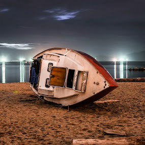 Beached by Cory Bohnenkamp - Transportation Boats ( lights, water, beached, ships, night, beach, boat, city,  )