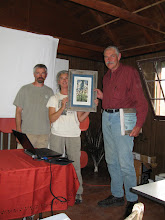 Photo: Camp - Beth Madden gives Doug Smith print of logo art with Dave helping