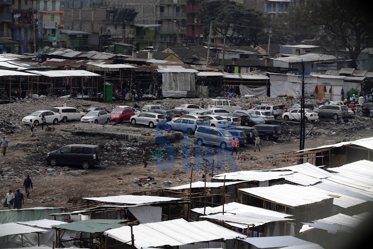 After the fire that razed Gikomba market, a private developer is now building a perimeter wall around the area. Traders have been evicted from that area and its now being used as a parking as seen in the photo dated July 14, 2020.
