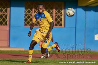Photo: Fitina OMBORENGA moves on to a superb cross from Emery BAYISENGE and heads towards goal  [Rwanda v Mauritius, AFCON 2017 Qualifier, 29 March 2016 in Kigali, Rwanda.  Photo © Darren McKinstry 2016, www.XtraTimeSports.net]