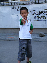 Photo: warrenzh 朱楚甲 posed on ground near his mom's house.