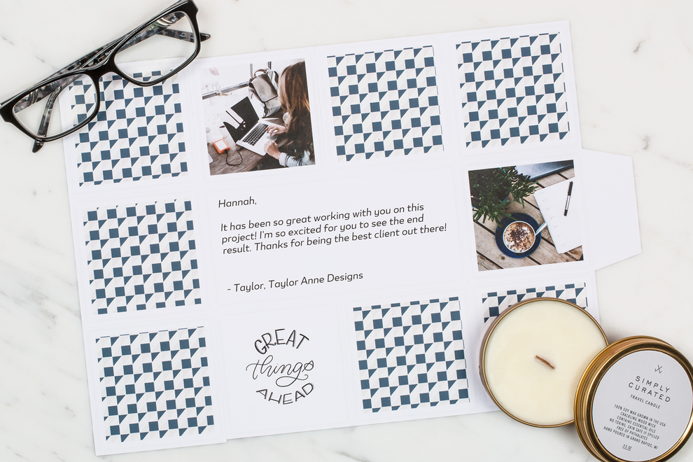 Image of open Greetabl gift, glasses, and candle.