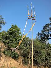 Photo: Ceremonial pole outside village temple