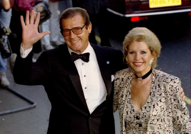 Roger Moore, accompanied by wife Luisa. Picture: REUTERS
