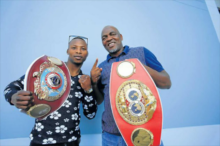 Boxing star Zolani Tete with his manager Mlandeli Tengimfene