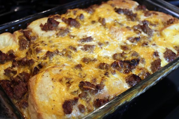 Casserole baking uncovered with melted cheese.