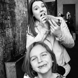 hungry by Mark Thompson - Food & Drink Eating ( grin, toothless, sisters, eating, hot dog,  )