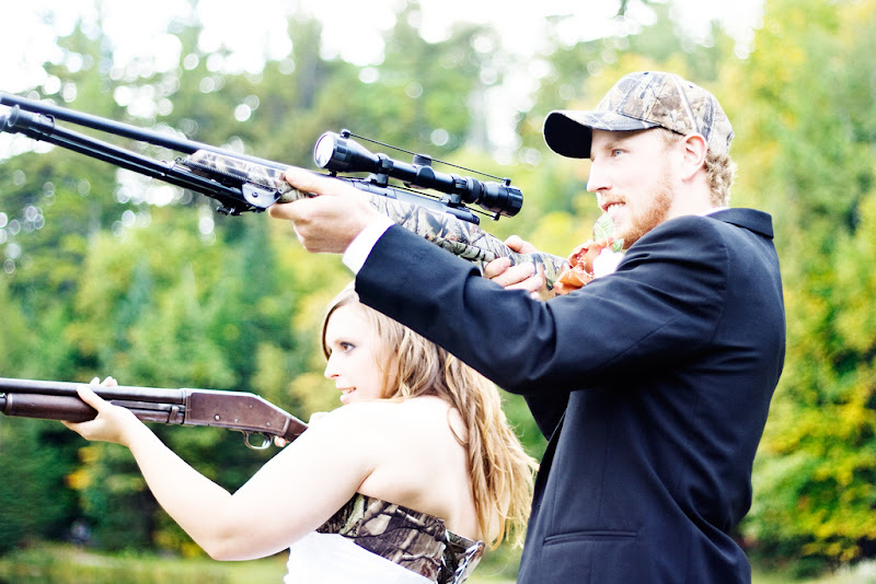 Photo: A shot of Julie and Mel with guns after the wedding.