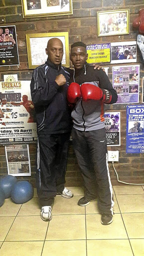 WBF All Africa junior flyweight boxing champion Mpho Seforo, right, and his new trainer Bernie Pailman.