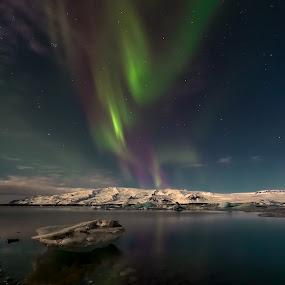 ... by Ruslan Stepanov - Landscapes Weather ( water, clouds, glacier, iceland, mountains, ice, stars, northern lights, aurora borealis, landscape, rocks, glacier lagoon )