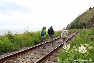 Photo: walking the rail along the lake