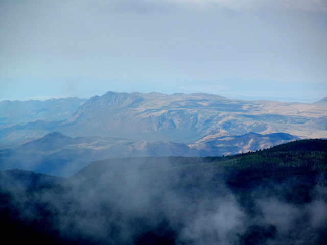 Distant mountains through the clouds