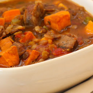 Lentil and Roasted Sausage Soup Recipe with Sweet Potatoes and Herbs.