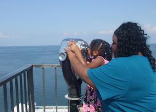 Photo: I'm helping Kaleya look through the binoculars.