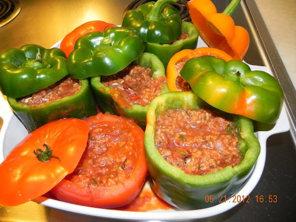 Stuff your peppers and tomatoes with mixture. Pour the reserved tomato sauce mixture around...