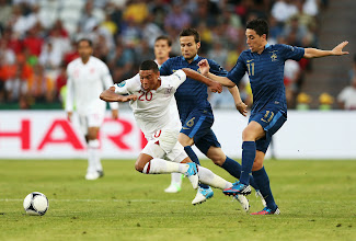 Photo: Alex Oxlade-Chamberlain of England is tackled by Samir Nasri of France during the UEFA EURO 2012 group D match between France and England at Donbass Arena on June 11, 2012 in Donetsk, Ukraine.