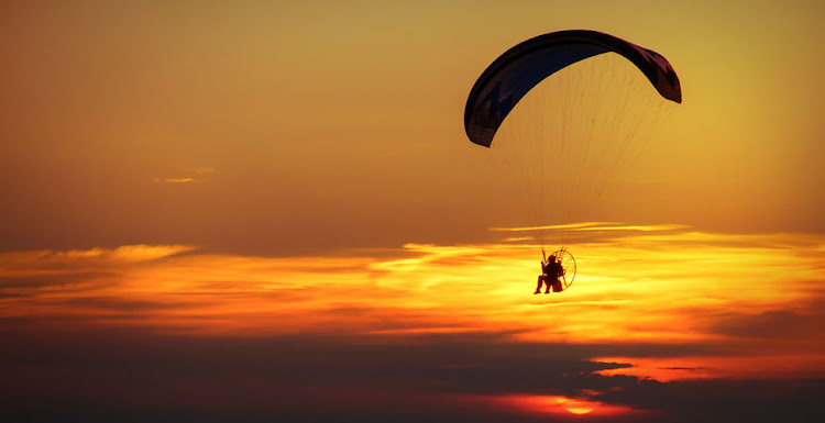 Man on a motorised paraglider. File photo.