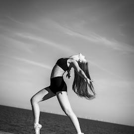 Ballet on the beach by Vix Paine - Babies & Children Child Portraits ( sky, blackandwhite, ballerina, moody, on pointe, balletonthebeach, ballet, ballet shoes, wall, sea, child, teenager )