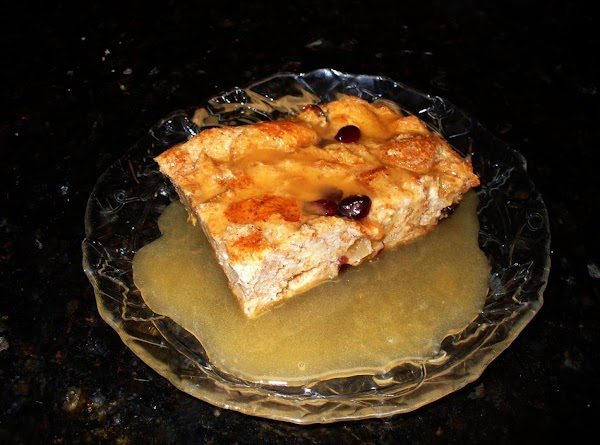 Serve the bread pudding with the warm rum sauce and enjoy!