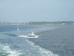Photo: Wake of the ferry and boats following.