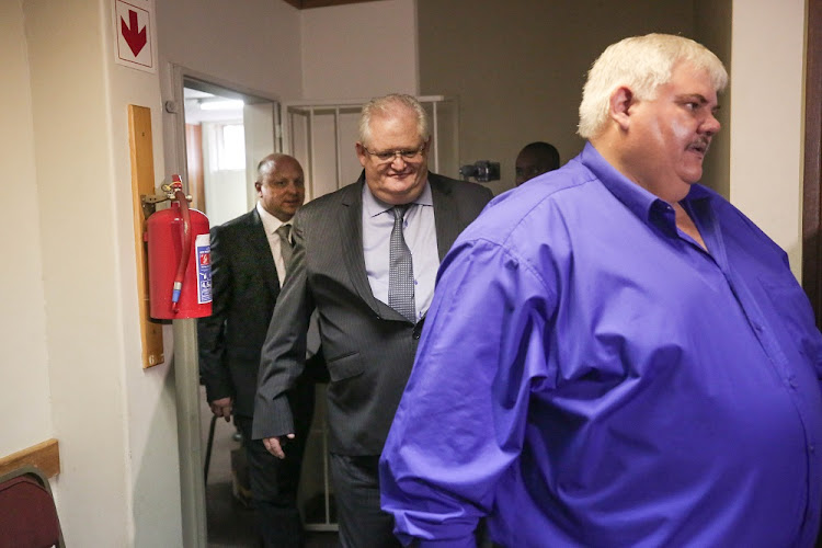 Front: Frans Voster, former Bosasa Chief Operations Officer Angelo Agrizzi (centre) and Andries Van Tonder make an appearance at the Specialised Commercial Crimes court in Pretoria following their evidence before the state capture commission of inquiry.