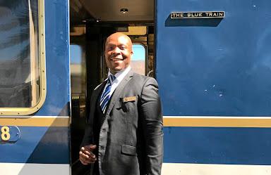All smiles:  Blue Train manager Bonga Mhlonga, right, makes passengers feel at home Picture: SUPPLIED