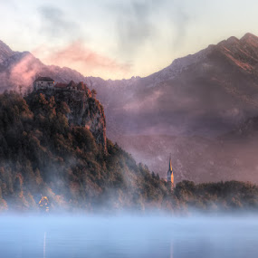 Bled Castle by Conor MacNeill - Landscapes Mountains & Hills ( water, hills, europe, church, bled castle, cliff, lake, morning, mountains, dawn, slovenia, bled, castle, julian alps, sunrise, misty, lake bled, mist, alps )