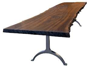 Photo: http://dorsetcustomfurniture.blogspot.com/2010/04/walnut-slab-table-is-done.html