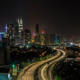 Kuala Lumpur at Night 12 by Daimasala Abdullah - Uncategorized All Uncategorized ( petronas, city, dusk, financial, skyline, scenery, malaysia, scenic, twilight, scene, view, modern, road, street, cityscape, avenue, place, highway, landmark, park, twin, architecture, shopping, kl, famous, reflection, business, metropolis, lumpur, night, center, mall, malaysian, centre, downtown, water, klcc, kuala, district, evening )