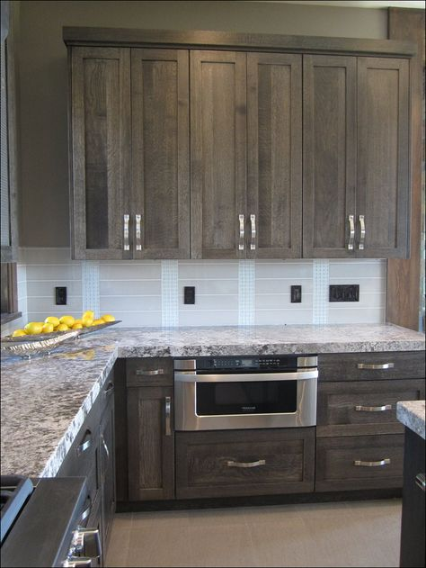 distressed grey shaker cabinets with chrome hardware in a galley kitchen. distressed grey cabinets are one of the best kitchen cabinet colors for 2020