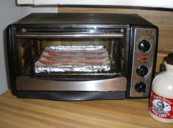 On a baking sheet with raised edges.  Place 4 strips of bacon. ...