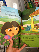 Photo: I always look inside the books to see if there are too many words on a page or if they concepts are simple enough for young kids.  You'd be surprised how many books look cute and then the text is terrible.  This Dora book makes the cut!