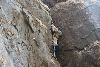 Photo: Richie Kher making his first aided moves off an old bolt into an offwidth using an aider and Metolius Easy Daisy. (Courtesy Ajit Bobhate)