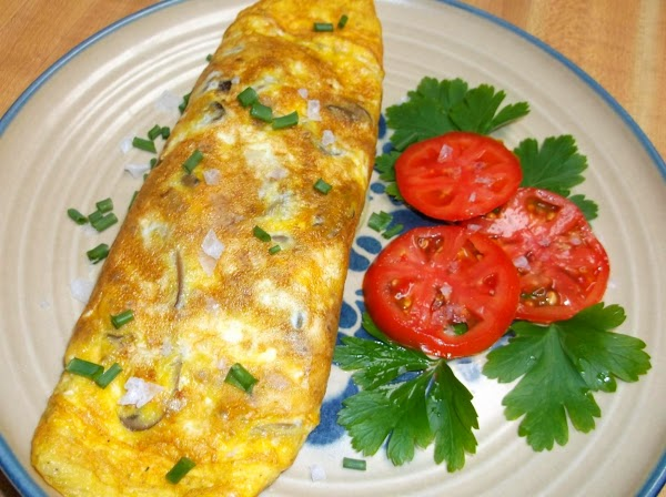 Immediately fold omelette in thirds or in half and transfer to plate.