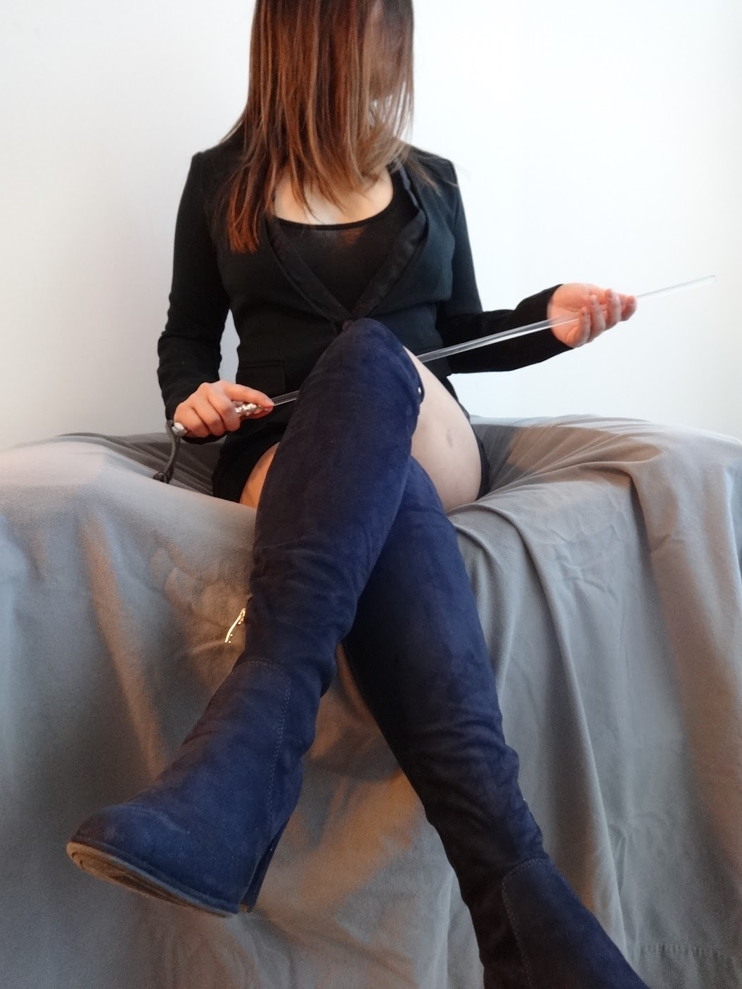 Asian domestic disciplinarian in thigh high boots