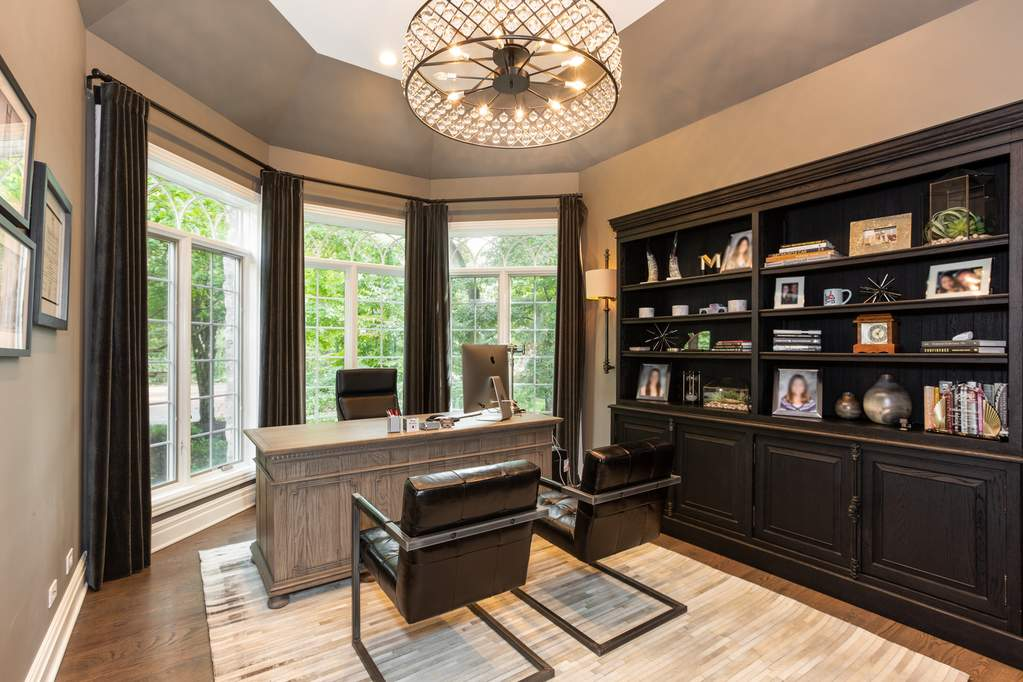 HDC office space with bay window and black chairs and shelving