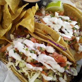 Shrimp Tacos with Crema and Salsa Verde.