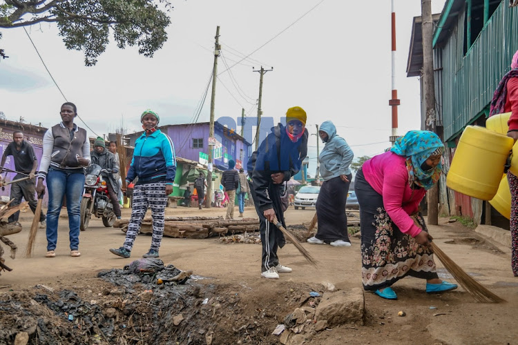 Kibera youths at Makina on 16th July 2020, participate in cleaning the streets with no proper protective gears to secure livelihoods amid the Coronavirus pandemic. .