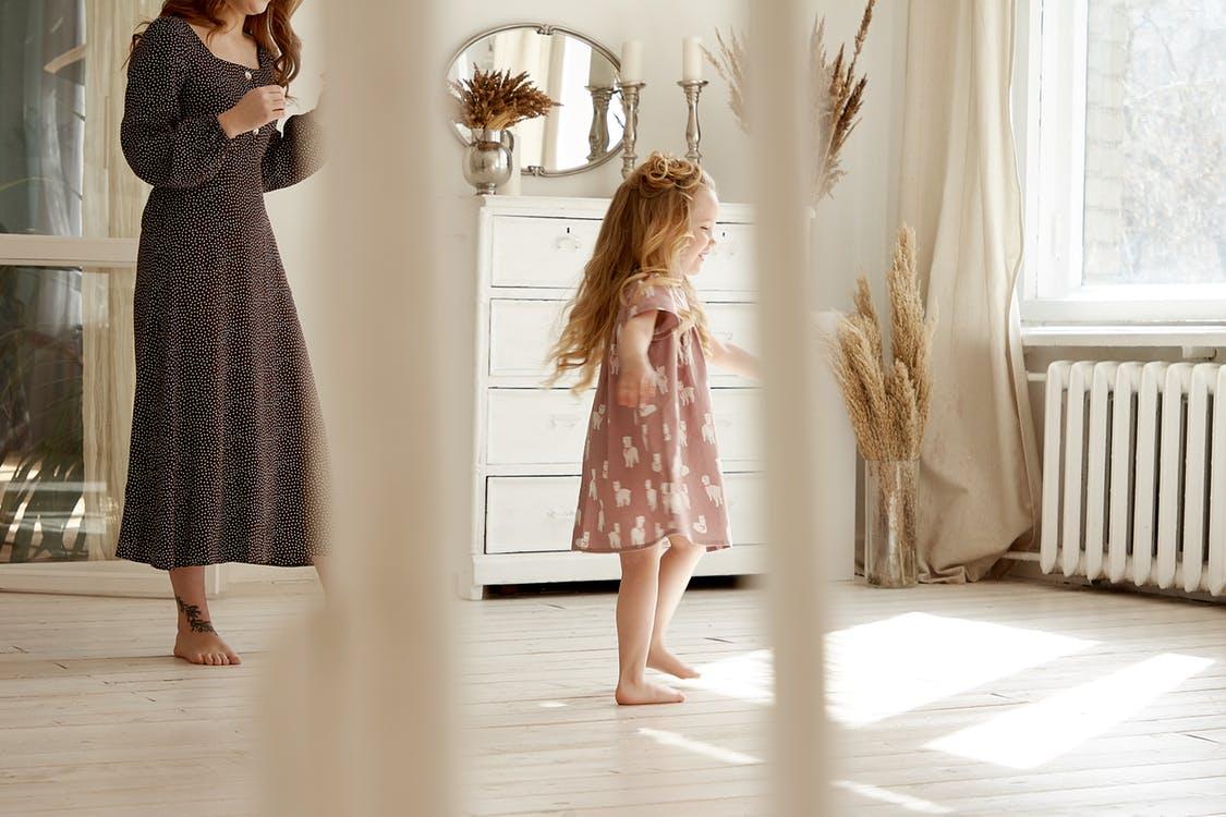 Woman Walking Behind Toddler