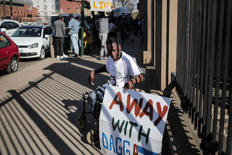 Moses Malatiie from Atteridgeville outside the North Gauteng High Court during protests against the legalisation of marijuana. Malatiie says that if marijuana is legalised we will loose the country to foreigners who will cross borders to sell the plant.