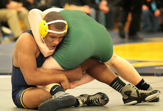 Photo: 182 Isaac Florell (Totino-Grace) over Kyle Kragnes (West Fargo) Dec 11-6. Photo by Jeff Beshey.
