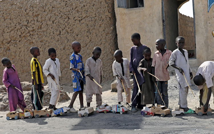 Boys play outside a bakery in Dapchi, in the northeastern state of Yobe, Nigeria.