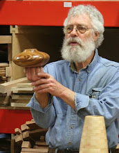 "Photo: Here, David looks at Eliot Feldman's uniquely-footed zebrawood hollow form upside down, saying that if a piece is ""right"", it will look just as good upside down as it will right side up.  This HF passes the test."