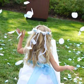 Little girl tossing petals by John & Sharon Green - Babies & Children Children Candids ( petals, grass, happy, wedding, flower girl,  )