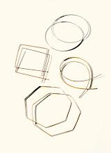 Photo: LANA 14k gold hoop earrings. White gold large hoops. $395. Rose gold medium diamond- shaped upside-down hoops. $465. Yellow gold large flat upside-down hoops. $390. Yellow gold rock hoops. $540. USA. 5F. 212 872 8967
