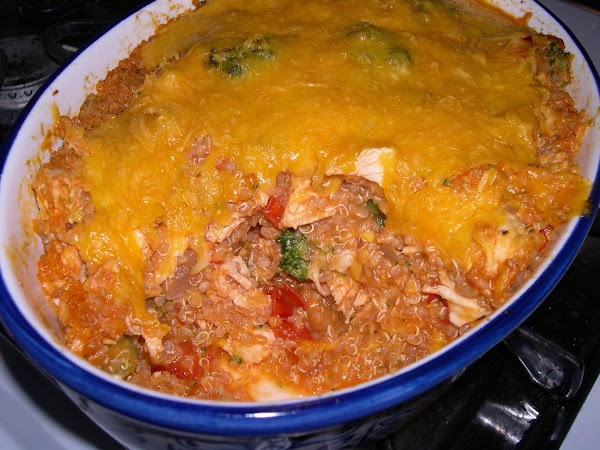 Now add your simmered tomato sauce to the chicken quinoa mixture. Toss gently to...