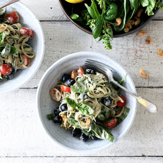 Raw Basil Zoodles with Black Olives, Tomatoes and Spicy Cashews.